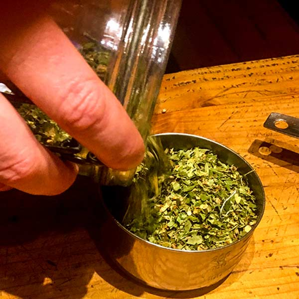 Measuring dried herbs in Magourney