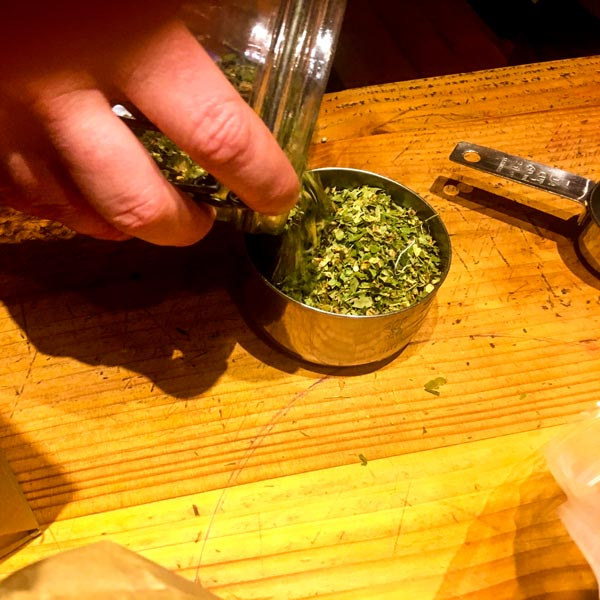 Measuring dried herb leaf